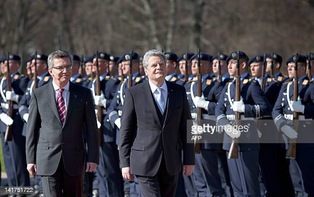 German new president Joachim Gauck and German Defence Minister Thomas de Maiziere review troops during his welcome ceremony with military honours...