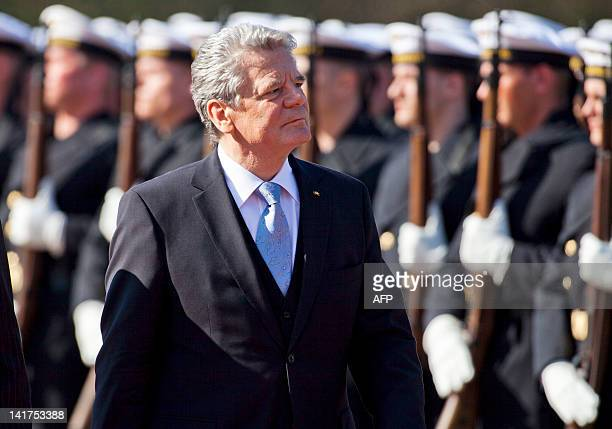 German new president Joachim Gauck reviews the troops during his welcome ceremony with military honours upon at the Bellevue Presidential Palace...