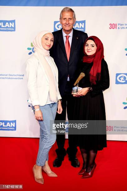 German news anchor Ulrich Wickert with the award winner Youth advocates during the Ulrich Wickert Award for Childen's Rights at Tipi am Kanzleramt on...