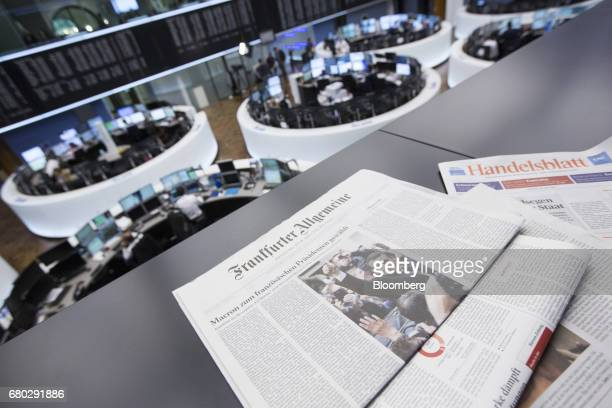 German newspapers including broadsheet Frankfurter Allgemeine Zeitung rest on a surface following the election of Emmanuel Macron as France's new...