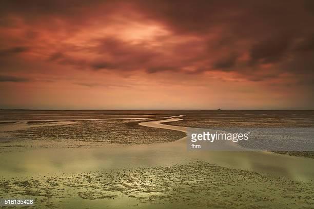 German north sea region - Wattenmeer at colorful sunset