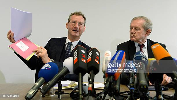 German notary Dieter Mayer and Karl Huber President of the Higher Regional Court Munich attend a press conference on April 29 2013 in Munich southern...