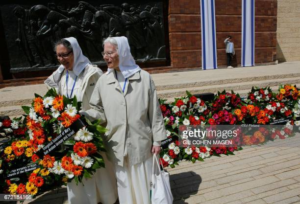 German nuns from the Evangelical Sisterhood of Mary lay a wreath during a ceremony marking the annual Holocaust Remembrance Day at the Yad Vashem...