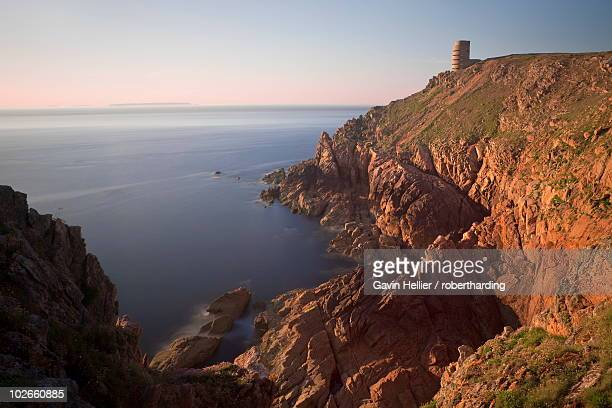wwii german observation tower and the rocky northwest coastline of jersey, channel islands, united kingdom, europe - gavin hellier stock pictures, royalty-free photos & images