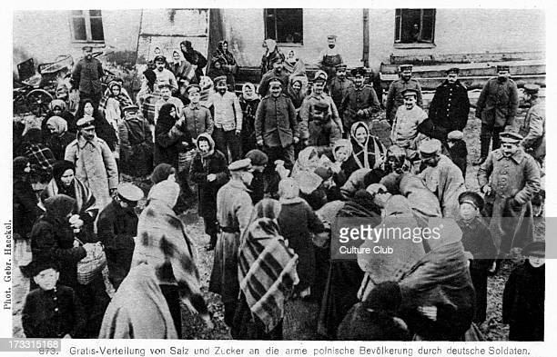 German Occupation on the Eastern Front in World War I Taken from photograph shows German soldiers handing over salt and sugar to impoverished Polish...