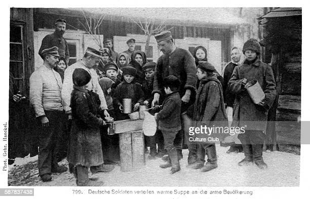 German Occupation on the Eastern Front in World War I Taken from photograph shows German soldiers distributing food among peasant adults and children...
