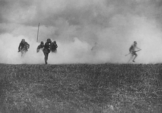 A German officer leads his men through a cloud of phosgene...