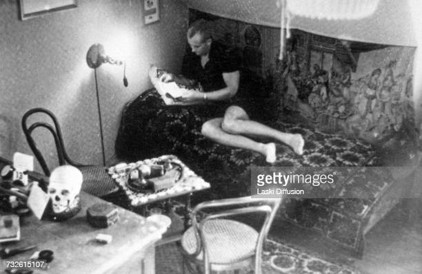 A German officer relaxing in his room with a skull on his desk Germanoccupied Poland circa 1942 A photo from an album documenting German atrocities...