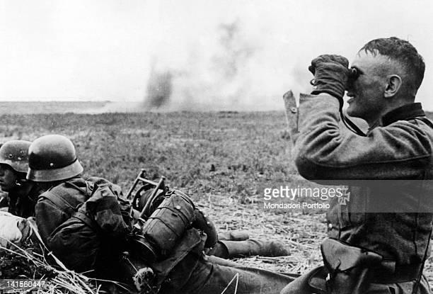 German officer using a pair of binoculars in an outpost during Kharkiv's battle Kharkiv May 1942