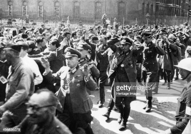 German officers surrendering, Rue de Rivoli, Paris, August 1944. World War Two: captured German officers walk with hands up.