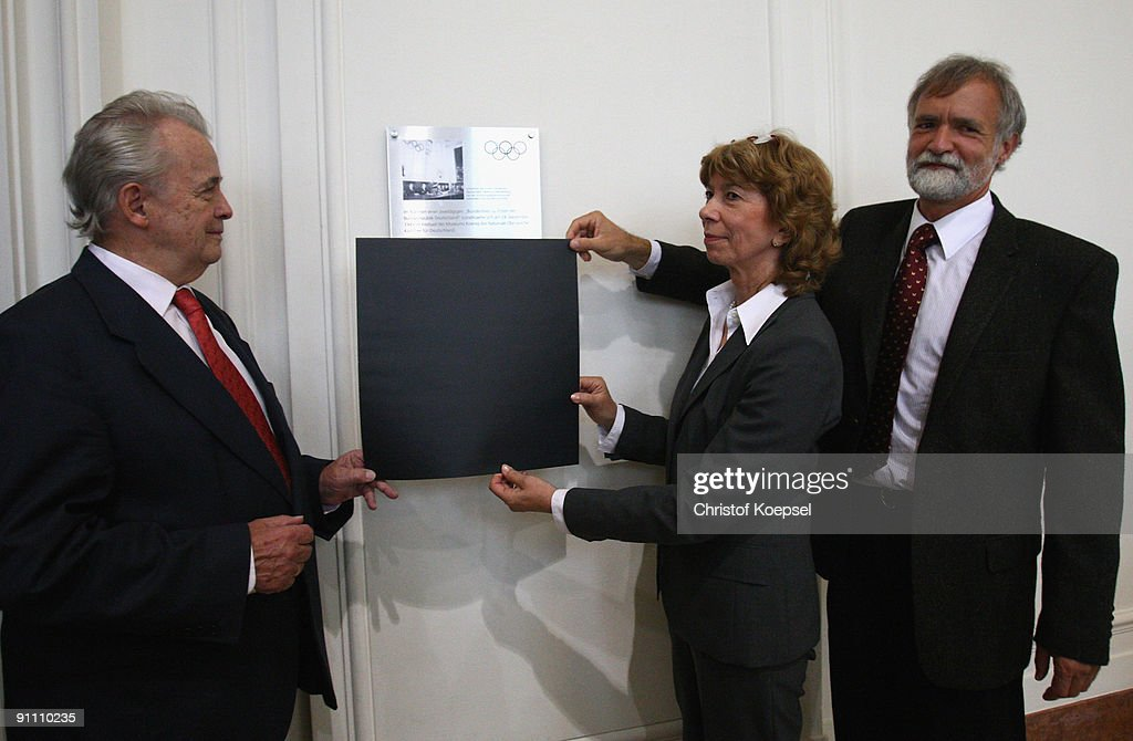 German Olympic Sports Federation vice president of culture and Olympic education doctor Gudrun Doll-Tepper, honory member of German Olympic Sports Federation Walther Troeger (L) and curator Wolfgang Waegele of museum Koenig unveil the memorial plaque during the 60th German National Olympic Committee anniversary at museum Koenig on September 24, 2009 in Bonn, Germany.