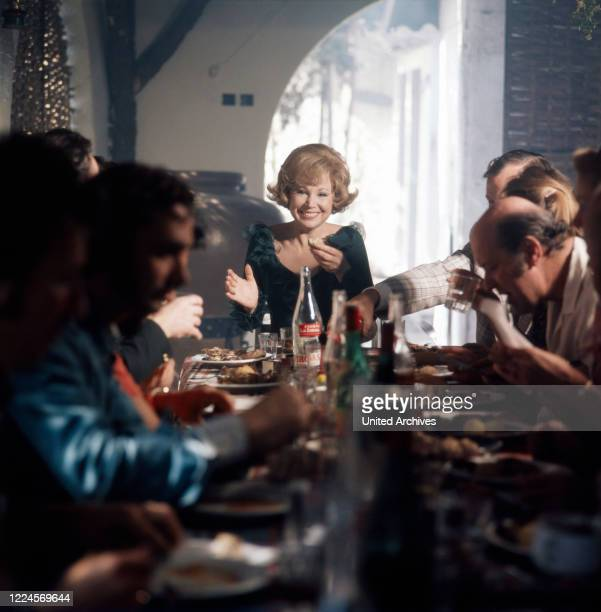 German opera singer Anneliese Rothenberger for a cosy gettogether after shooting a song with German pop singer Costa Cordalis 1970s