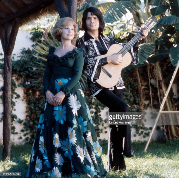 German opera singer Anneliese Rothenberger shooting a song with German pop singer Costa Cordalis, 1970s.