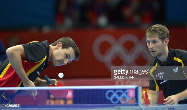 German pair Timo Boll and Bastian Steger compete against Austria's Robert Gardos and Chen Weixing during a table tennis men's team quarterfinal match...
