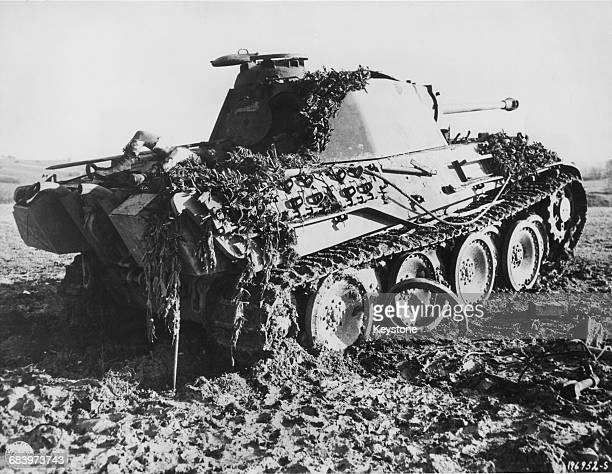 A German Panzerkampfwagen V Panther medium tank is knocked out during allied offensive operations on 13 December 1944 in Schalbach France