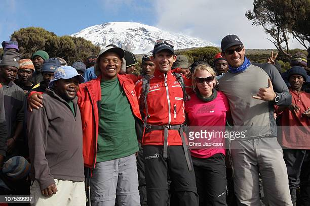German Paralympic cyclist Michael Teuber Gail Emms and expedition leader Mark Kalch pose with porters and guides at Millenium Camp on day seven of...
