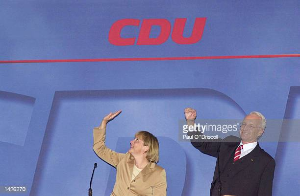 German parliamentary candidate Edmund Stoiber of the Christian Social Union and Angela Merkeel of the Christian Democratic Union celebrate their...