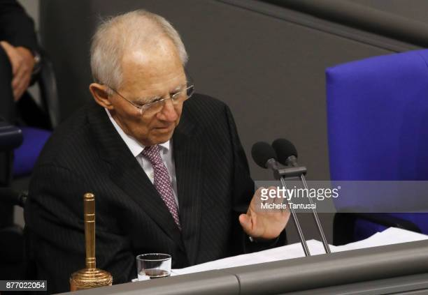 German parliament's President and former finance minister Wolfgang Schaeuble gestures as he speaks during the first session of the Bundestag the...
