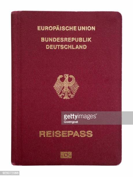 german passport isolated on a white background - germany stock pictures, royalty-free photos & images