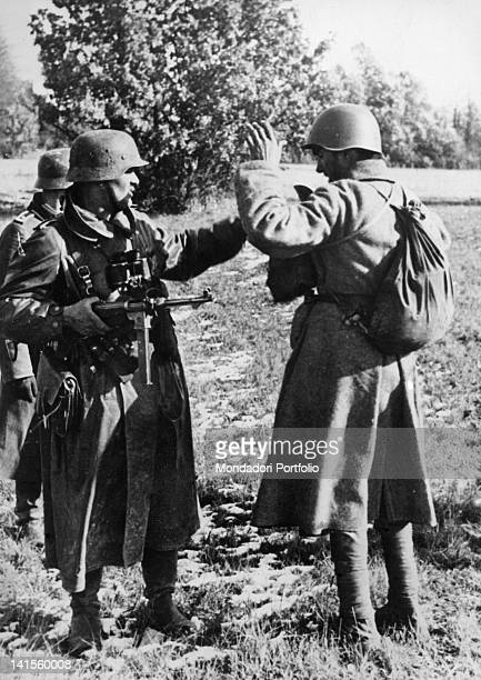 A German patrol in action in the Moscow area searching a captured Soviet soldier Moscow October 1941