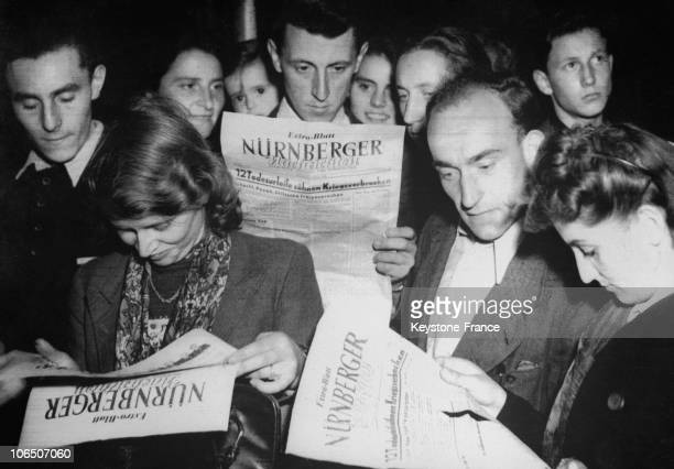 German People Reading The Reports Of The Trial Of Nazi Torturers
