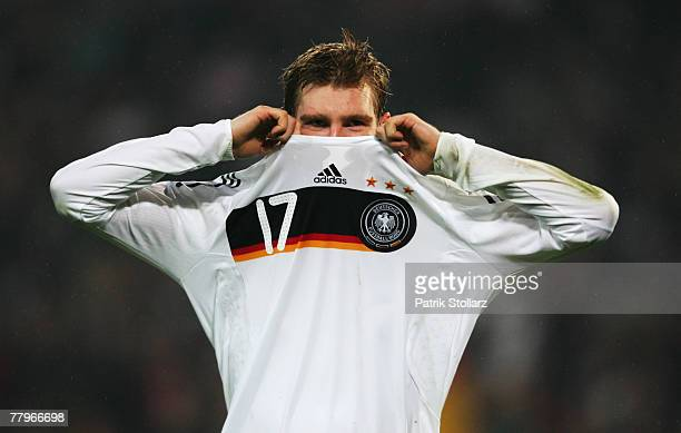 German Per Mertesacker pull off his jersey during the Euro 2008 Group D qualifying match between Germany and Cyprus at the WM Stadium on November 17...