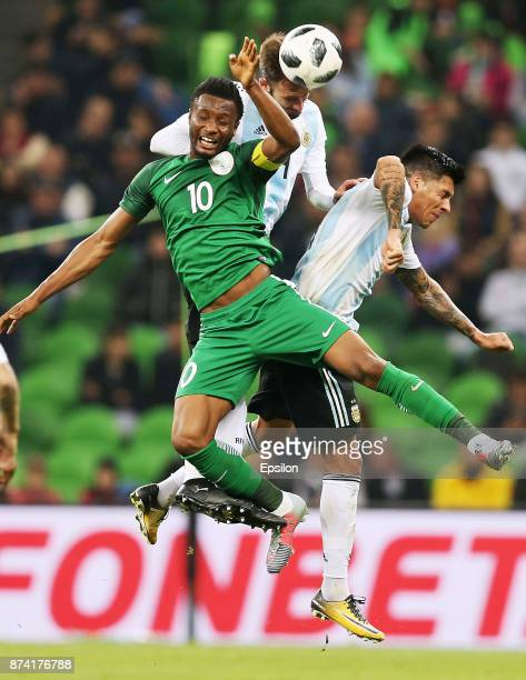 German Pezzella and Enzo Perez of Argentina go for a header with John Obi Mikel of Nigeria during an international friendly match between Argentina...