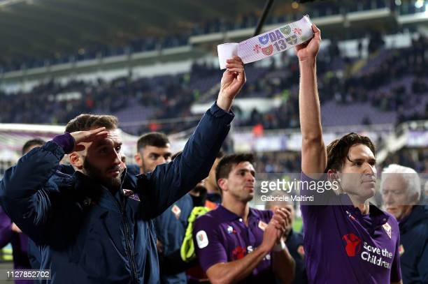German Pezzella and Federico Chiesa of ACF Fiorentina show a sign with the number 13 worn by Davide Astori during the Coppa Italia match between ACF...