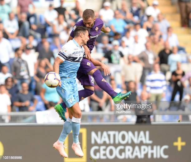 German Pezzella and Stefan Radu during the Italian Serie A football match between SS Lazio and Fiorentina at the Olympic Stadium in Rome on october...