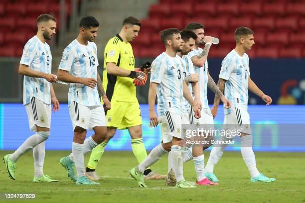 German Pezzella, Cristian Romero, goalkeeper Emiliano Martinez, Nicolas Tagliafico, Lionel Messi, Rodrigo De Paul leave the field after winning a...