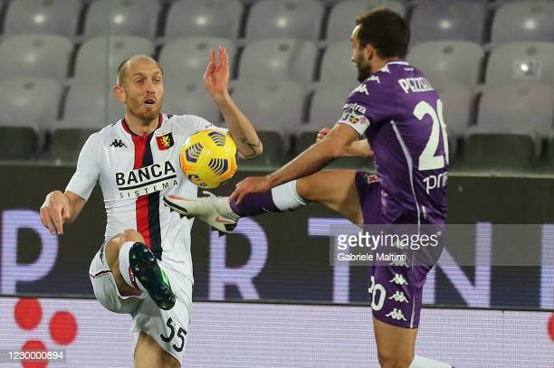 German Pezzella of ACF Fiorentina battles for the ball with Andrea Masiello of Genoa CFC during the Serie A match between ACF Fiorentina and Genoa...