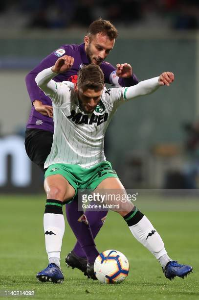 German Pezzella of ACF Fiorentina battles for the ball with Domenico Berardi of US Sassuolo during the Serie A match between ACF Fiorentina and US...