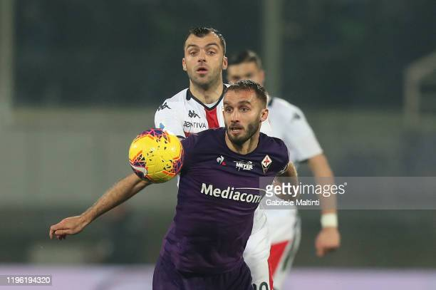 German Pezzella of ACF Fiorentina battles for the ball with Goran Pandev of Genoa CFC during the Serie A match between ACF Fiorentina and Genoa CFC...