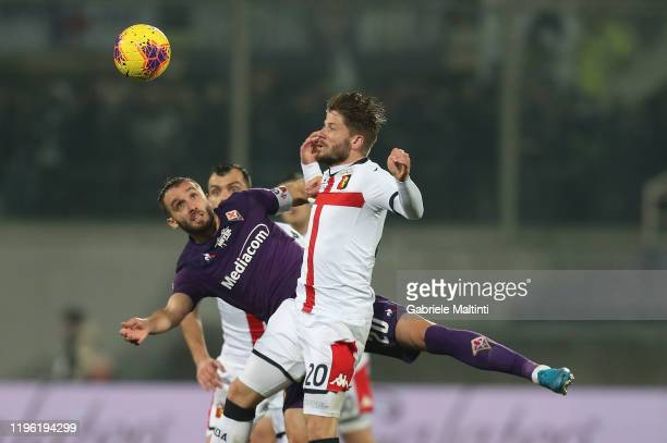 German Pezzella of ACF Fiorentina battles for the ball with Lasse Schone of Genoa CFC during the Serie A match between ACF Fiorentina and Genoa CFC...