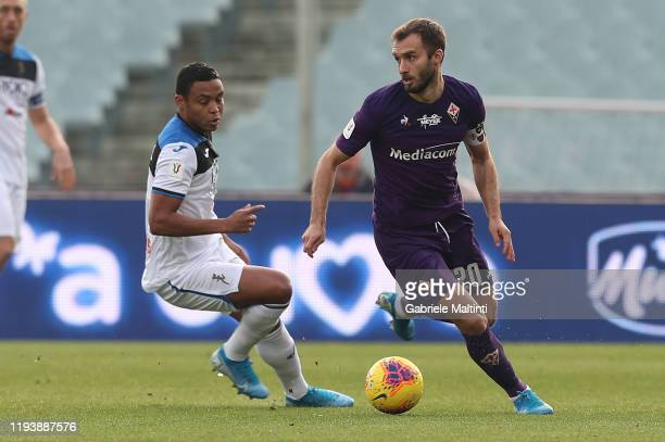 German Pezzella of ACF Fiorentina battles for the ball with Luis Muriel of Atalanta BC at Stadio Artemio Franchi on January 15 2020 in Florence Italy