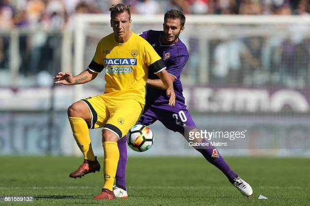 German Pezzella of ACF Fiorentina battles for the ball with Maxi Lopez of Udinese Calcio during the Serie A match between ACF Fiorentina and Udinese...