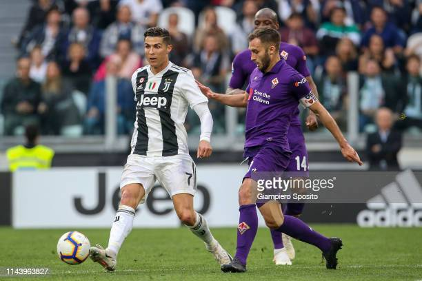 German Pezzella of ACF Fiorentina challenges Cristiano Ronaldo of Juventus during the Serie A match between Juventus and ACF Fiorentina on April 20...