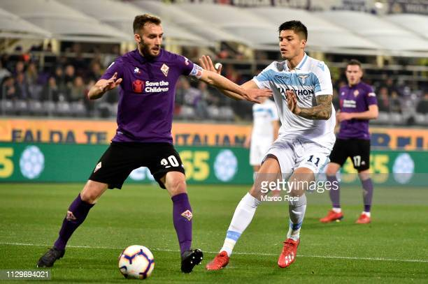 German Pezzella of ACF Fiorentina compete for the ball with Joaquin Correa of SS Lazio during the Serie A match between ACF Fiorentina and SS Lazio...