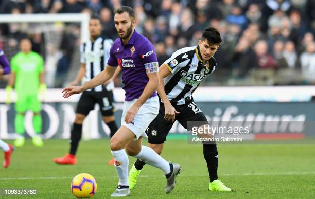 German Pezzella of ACF Fiorentina competes for the ball with Ignacio Pussetto of Udinese Calcio during the Serie A match between Udinese and ACF...