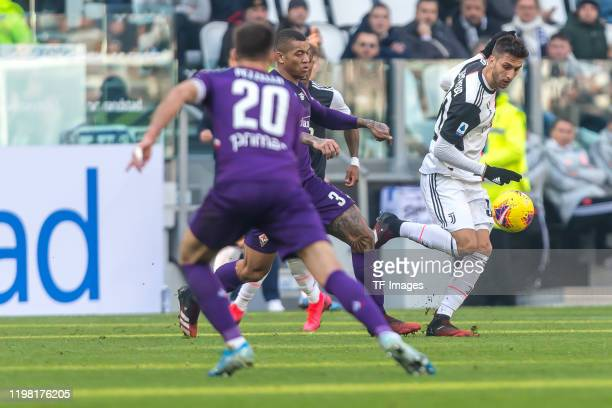 German Pezzella of ACF Fiorentina Igor of ACF Fiorentina and Rodrigo Bantancur of Juventus battle for the ball during the Serie A match between...