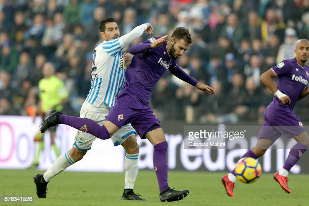 German Pezzella of ACF Fiorentina in action against Marco Borriello of Spal during the Serie A match between Spal and ACF Fiorentina at Stadio Paolo...