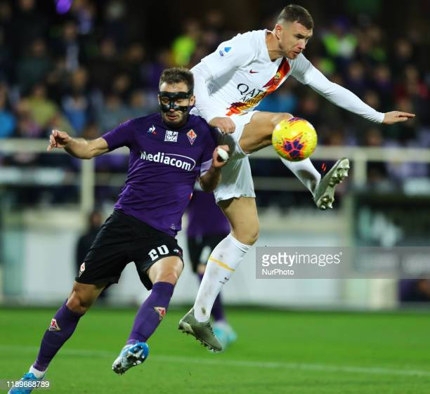 German Pezzella of Fiorentina and Edin Dzeko of Roma in action during the football Serie A match Ac Fiorentina v AS Roma at the Artemio Franchi...