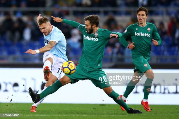 German Pezzella of Fiorentina tackling on Ciro Immobile of Lazio during the Italian Serie A football match Lazio vs Fiorentina at the Olympic Stadium...