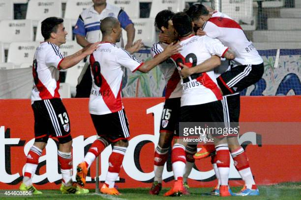 German Pezzella of River Plate celebrates with teammates after scoring the opening goal during a first leg match between Godoy Cruz and River Plate...