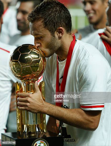 German Pezzella of River Plate kisses the trophy after winning the second leg match between San Lorenzo and River Plate as part of Recopa...
