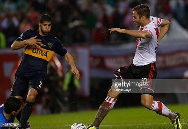 German Pezzella of River Plate scores the first goal of his team during a match between River Plate and Boca Juniors as part of 10th round of Torneo...