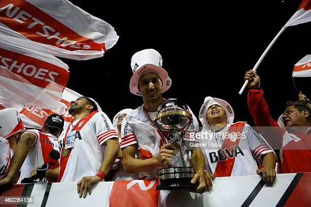 German Pezzella of River Plater holds the Copa Sudamericana Trophy after the second leg final match between River Plate and Atletico Nacional as part...