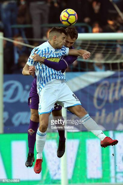 German Pezzella of Spal battles for the ball with Alberto Paloschi of ACF Fiorentina during the Serie A match between Spal and ACF Fiorentina at...