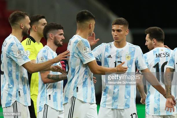 German Pezzella, Rodrigo De Paul, Joaquín Correa and Nicolas Dominguez of Argentina celebrate after winning a group A match between Argentina and...