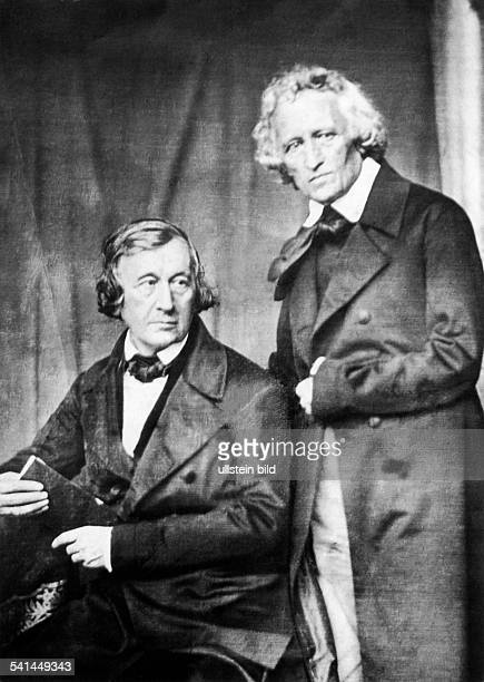 GRIMM BROTHERS 1847 German philologists and mythologists Jacob Grimm standing and his brother Wilhelm German daguerreotype by Hermann Biow
